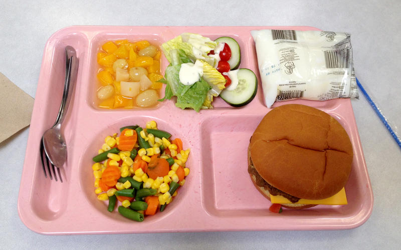 Today's school lunch includes healthier spins on old standards. This meal at a Nebraska high school includes a hamburger with no cheese on a whole wheat bun and a fresh salad, instead of french fries.