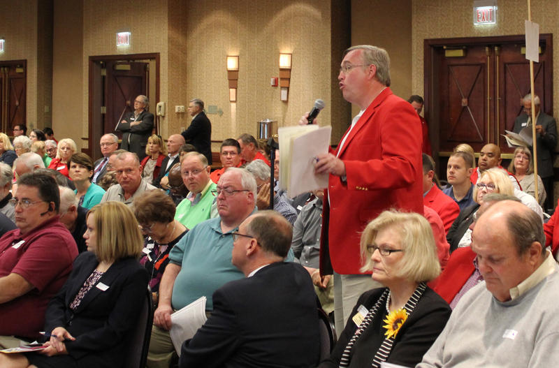Jeffrey Locke, a teacher from Satanta, stands to argue for his motion to add support for the death penalty to the Kansas Republican Party platform.