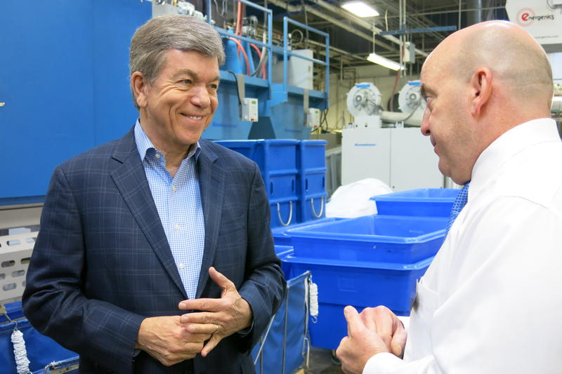 U.S. Senator Roy Blunt, R-Missouri, speaks to Faultless Linen Chief Operating Officer Mark Spence during a Kansas City stop Monday, May 2, 2016.