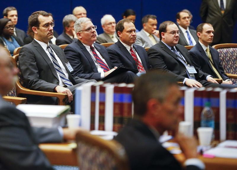 Attorney General Derek Schmidt, left, along with other state officials, look on as the state Supreme Court hears oral arguments Tuesday morning regarding the Legislature's fix to supplying equitable funding to schools.