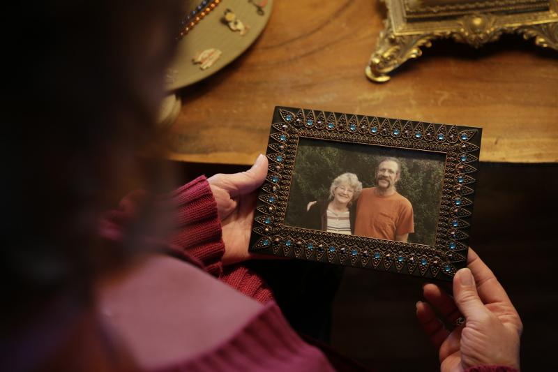 Greata Horner holds a photo of her and her husband Ed taken a few months before he died.