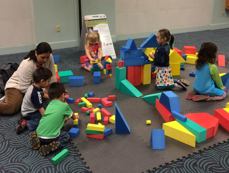 The Topeka USD 501 Parents as Teachers program plans to continue to offer events like Blockfest, shown here, to parents with young children who want to participate. But funding cuts may mean the number of events will be reduced.