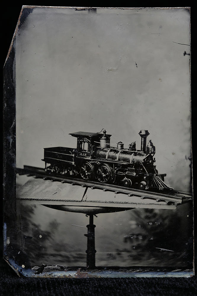 A tintype still life of a child's train.