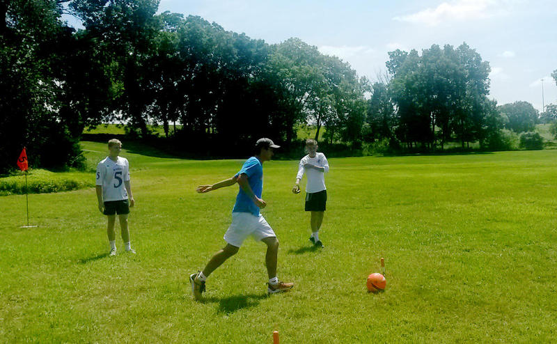 Kicking styles in FootGolf vary with some players kicking straight-on and others using a soccer-style kick.