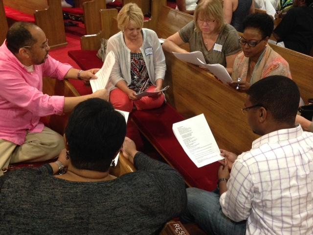 Members meet in small groups to discuss common questions.
