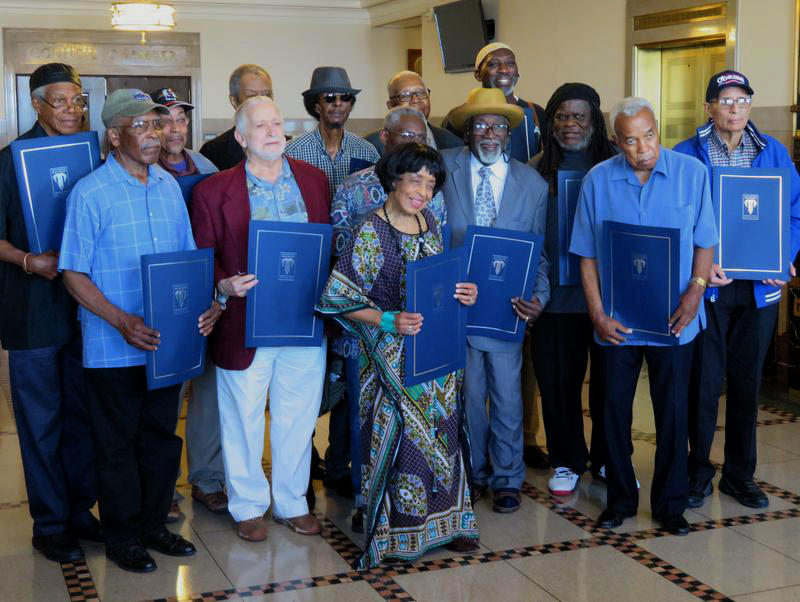 Members of colored musicians unions from around the country pose with resolutions in their honor at City Hall in Kansas City, Missouri.