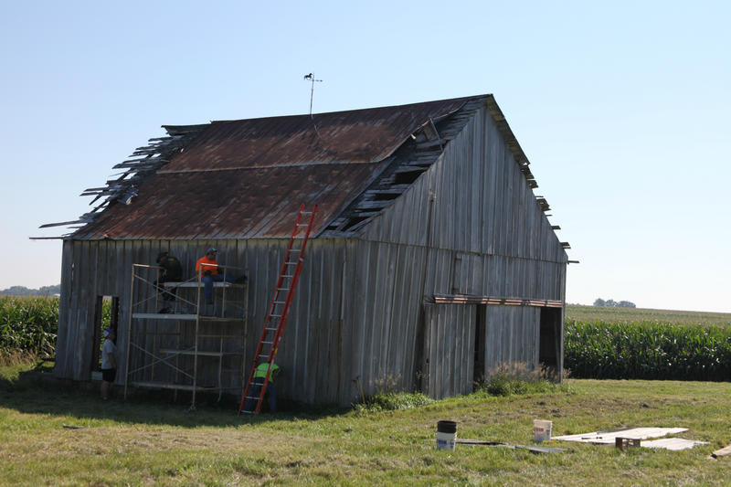 Contractor Mike Hudson and his team pull apart an old barn in Malta Bend, Missouri. The pieces will be sold as reclaimed wood.