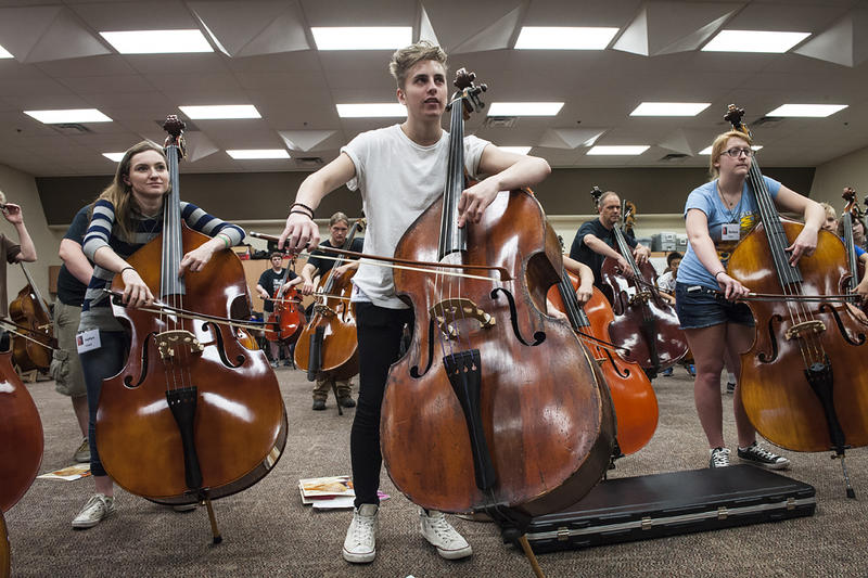 Students from nine states concentrate as they rehearse during a class at the seventh annual Kansas City Bass Workshop.