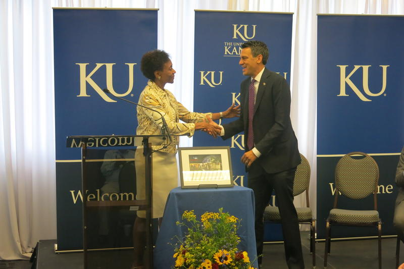 KU Chancellor Bernadette Gray-Little presents Rep. Kevin Yoder, R-Kansas, with the Champion of Science award.