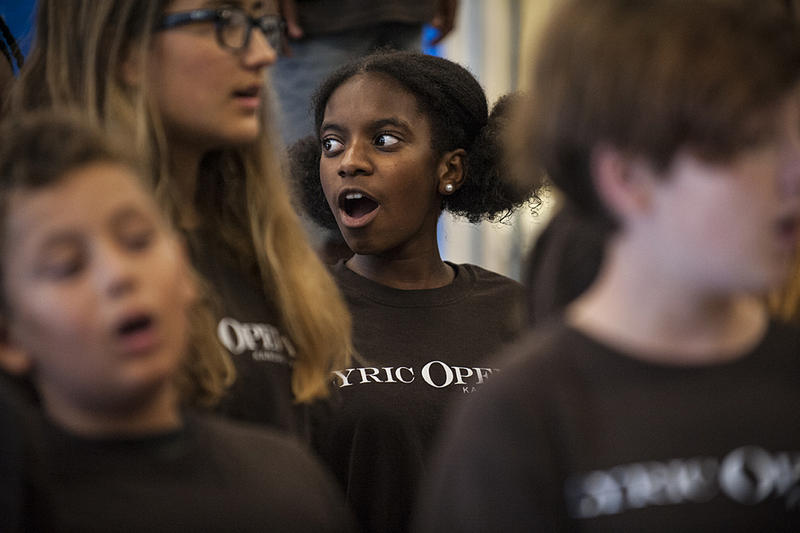 Eleven-year-old Sa'Mya Sharay Lewis (center) sings with other opera campers.