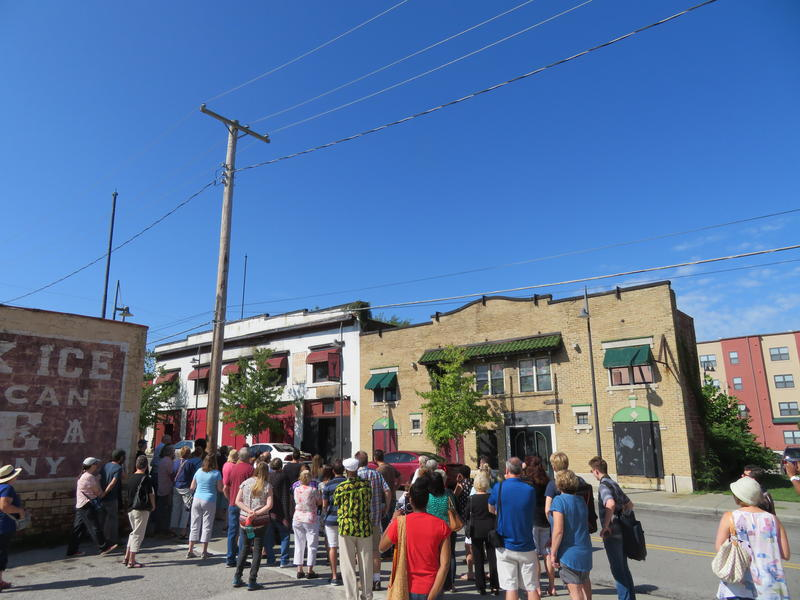 About 75 people attended a tour of the Historic 18th and Vine District as part of Kansas City's annual Charlie Parker Celebration. They stopped across the street from the former Eblon Theater at 1822 Vine.