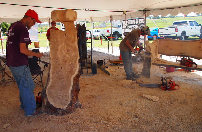 Matthew Loper of Grandview, Indiana, at left, and Sam Dunning of Benton, Kentucky, work on sculptures at the Adams County, Illinois, fair.