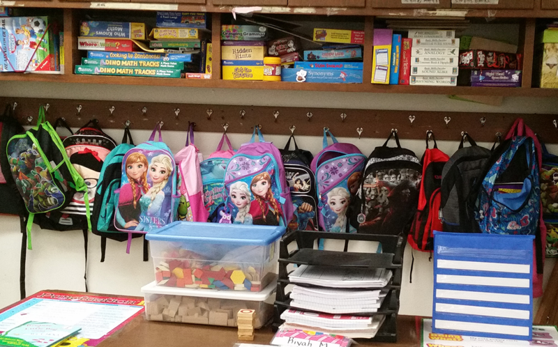 Backpacks line a wall in Aubrey's Paine's 2nd grade classroom at Ingels Elementary School.