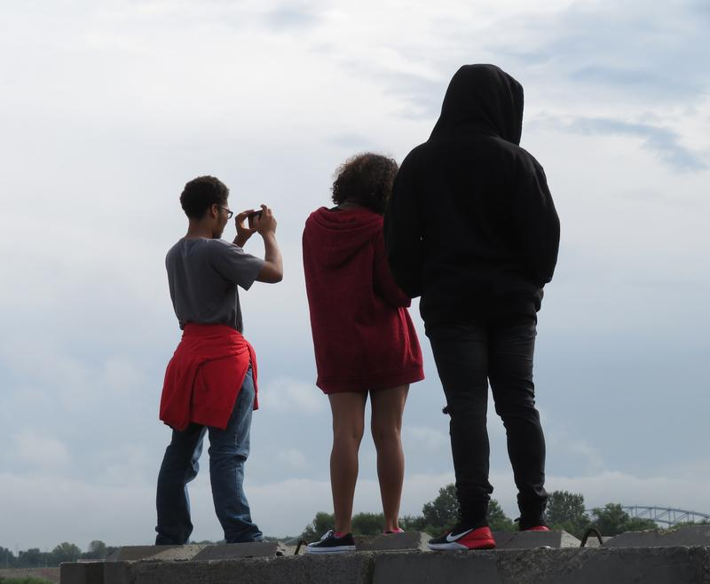 Students on Paul Dorrell's annual field trip get an artistic view of Kansas City's skyline from the lot at the Port of Kansas City's Woodswether Terminal on the banks of the Missouri River.