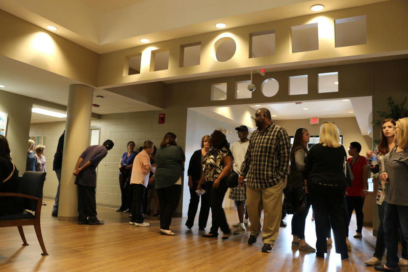 Visitors streamed into the lobby of the Kansas City Assessment and Triage Center on Friday, marking the ceremonial opening of the mental health crisis center set to begin operating Monday at 12th Street and Prospect Avenue.