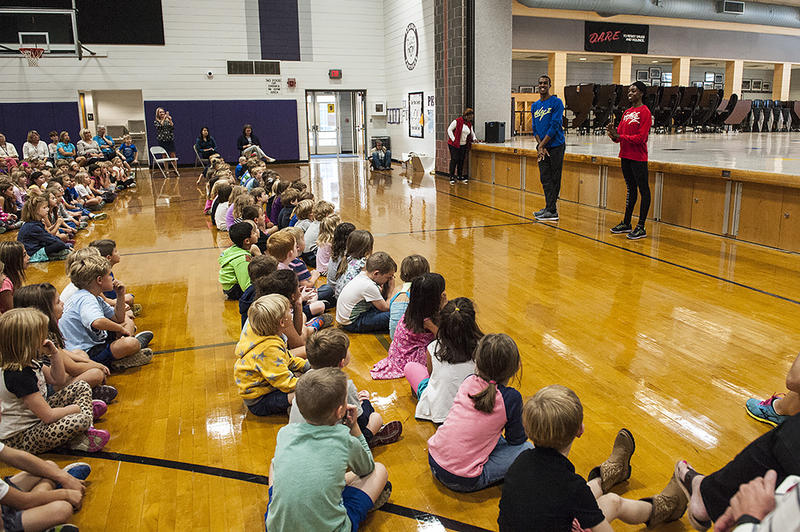 Pruitt and Campbell speak to an audience of elementary school students.
