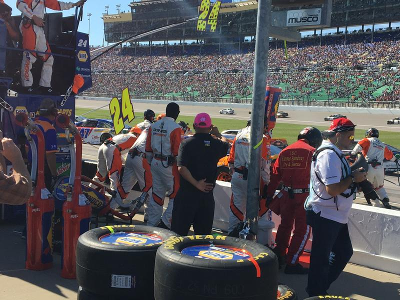 NASCAR driver Chase Elliott's pit crew goes to work on his car at the Kansas Speedway.