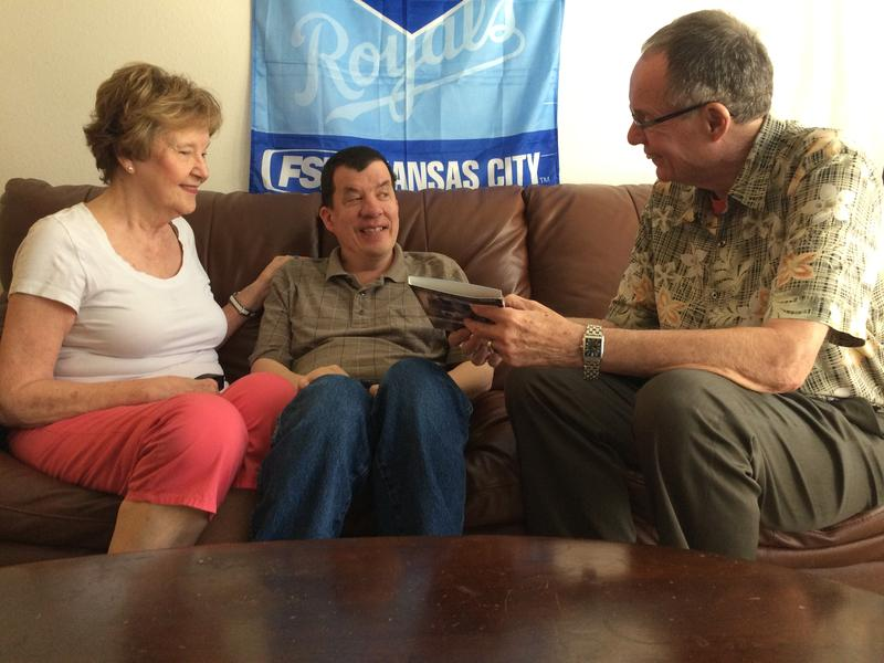 Nick Fugate (center) and his parents, Julie and Ron, have been adjusting to life on Kansas' Medicaid waiting list for the developmentally disabled.