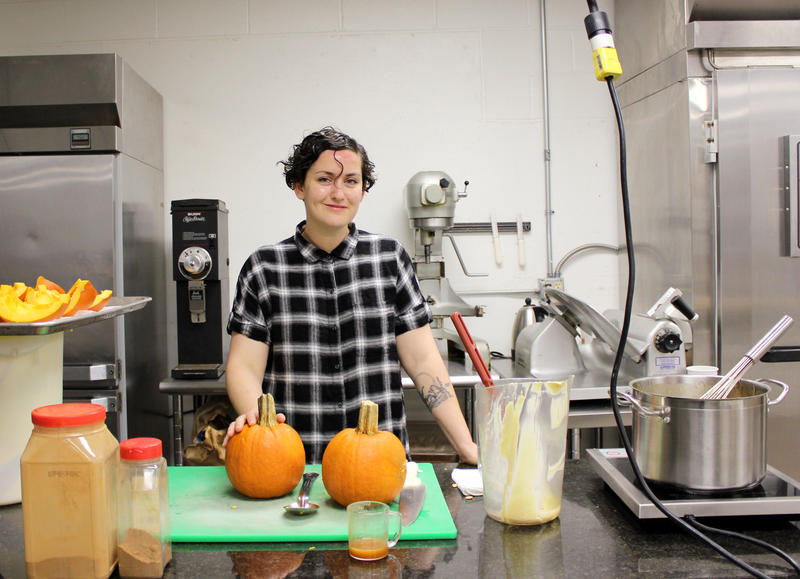 Beverage Development Specialist Kate Blackman prepares the ingredients for her pumpkin caramel latte at the Parisi Coffee production plant.