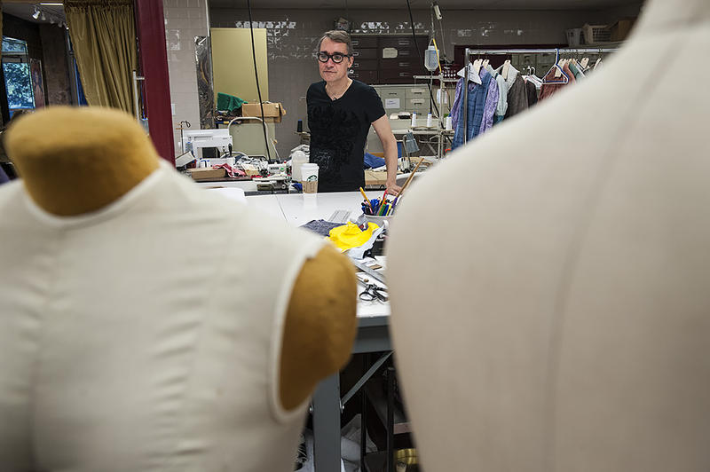 London-based Set and Costume Designer Leslie Travers oversees the progress on 18th-century costumes at a cutting table at Kansas City Costume Company.
