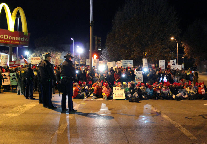 Over 400 gathered for the Fight for $15 march to the corner of Troost Avenue and Meyer Boulevard. The protesters who chose to sit in the street were arrested one by one.