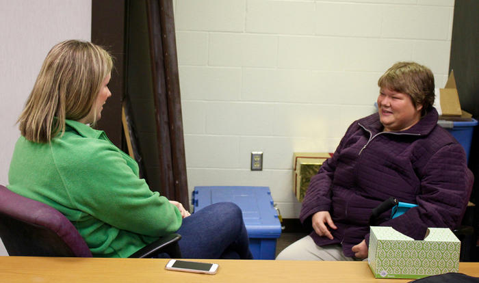 Kim Turley, left, of the Topeka Rescue Mission talks with Ashlyn Harcrow, who is staying at the mission as she recovers from domestic violence and tries to improve her mental health amid post-traumatic stress disorder, depression and anxiety.