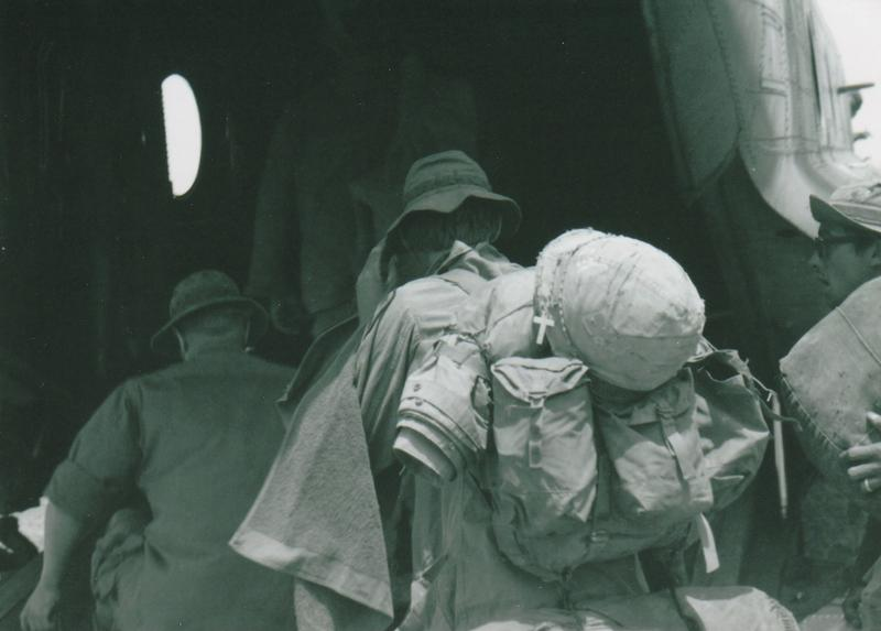 "James Hugo Rifenbark took this photograph of soldiers boarding a Chinook for Bien Hoa Air Base on their way home from Vietnam. ""The cross got my attention,"" he says. It's published in Volume 5 of 'Proud to Be: Writing by American Warriors.'"