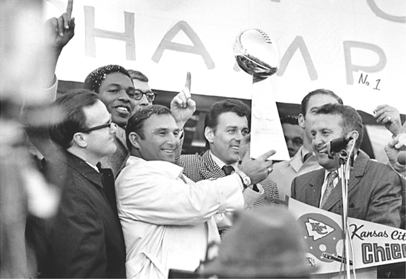 Chiefs owner Lamar Hunt (left) stands near Head Coach Hank Stram at a celebration shortly after the team won Super Bowl IV against the Minnesota Vikings in 1970.