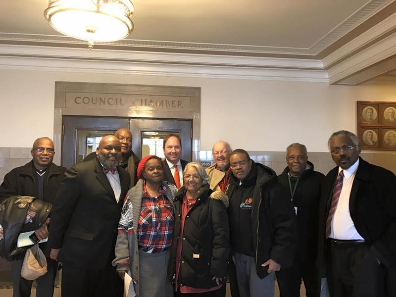 Rev. Dr. Vernon Howard, second from left, stands outside the Kansas City Counicil chambers with other supporters of a one-eighth cent salex tax to benefit Kansas City's urban core. The citizen-led petition initiative will be on the April ballot.