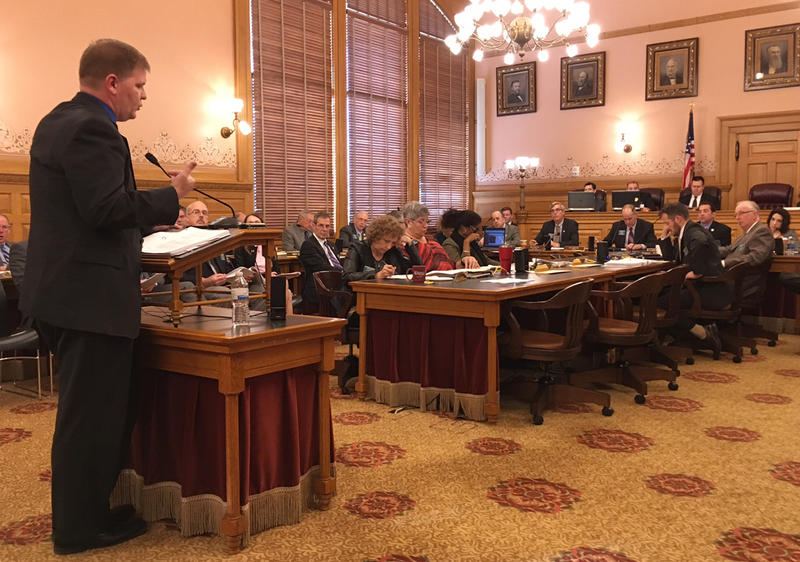 Budget Director Shawn Sullivan outlined Gov. Sam Brownback's budget proposal Wednesday at the Statehouse. The governor's proposed budget continues to rely on one-time fixes.