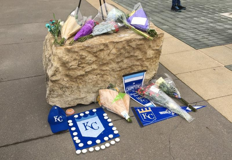 Fans placed flowers and other items near the entrance to Kauffman Stadium.