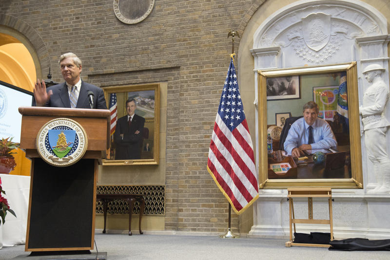 Agriculture Secretary Tom Vilsack unveils his official portrait at the U.S. Department of Agriculture in December 2016.