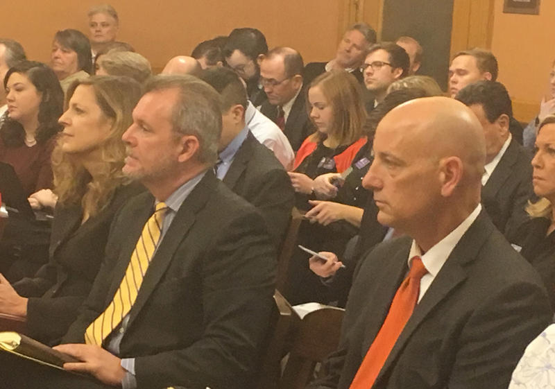 Kansas officials have responded to a federal request for a plan to fix deficiencies in the state's Medicaid program. Those officials include Mike Randol, center, of the Kansas Department of Health and Environment.