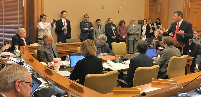 Kansas Secretary of State Kris Kobach responds to a question from Sen. Randall Hardy, left, during Tuesday's hearing on voter registration requirements.