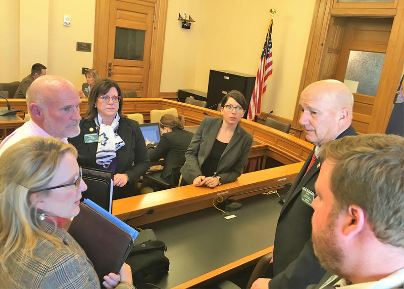 Rep. Debbie Deere, a Democrat from Lansing and Natalie Scott, a House Corrections and Juvenile Justice Committee staff member, look on.