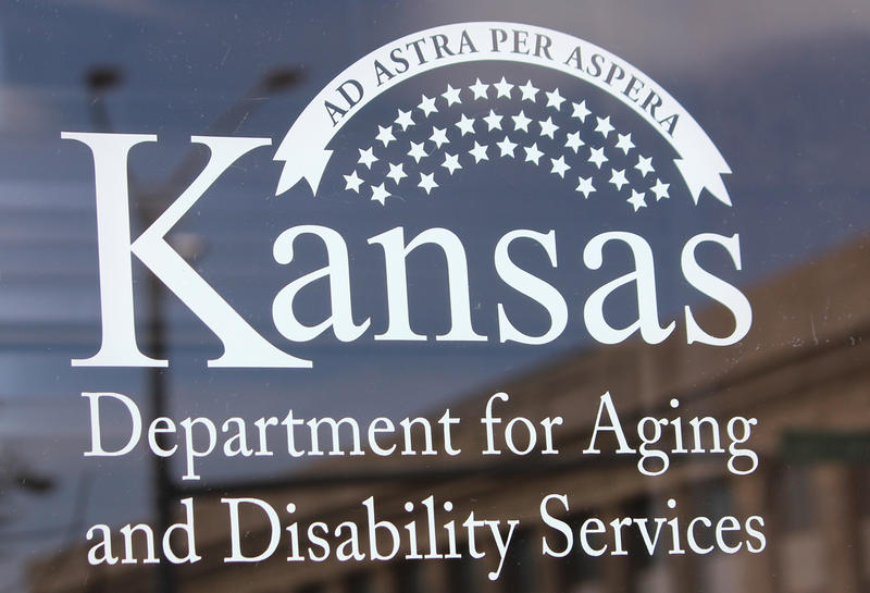 A newspaper report published over the weekend says a former official at the Kansas Department for Aging and Disability Services continued to work at the agency even after he faced allegations of sexual harassment.