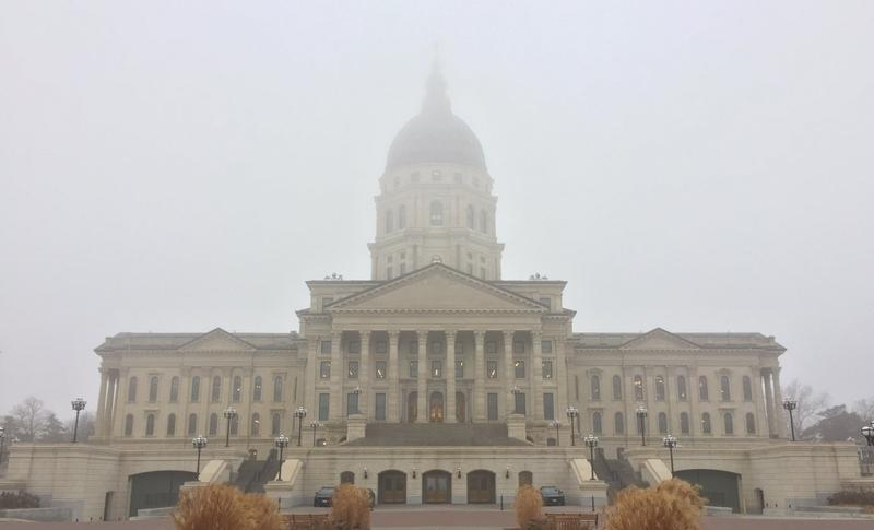 A Kansas Senate committee has advanced a bill that would repeal an income tax exemption for more than 300,000 business owners.