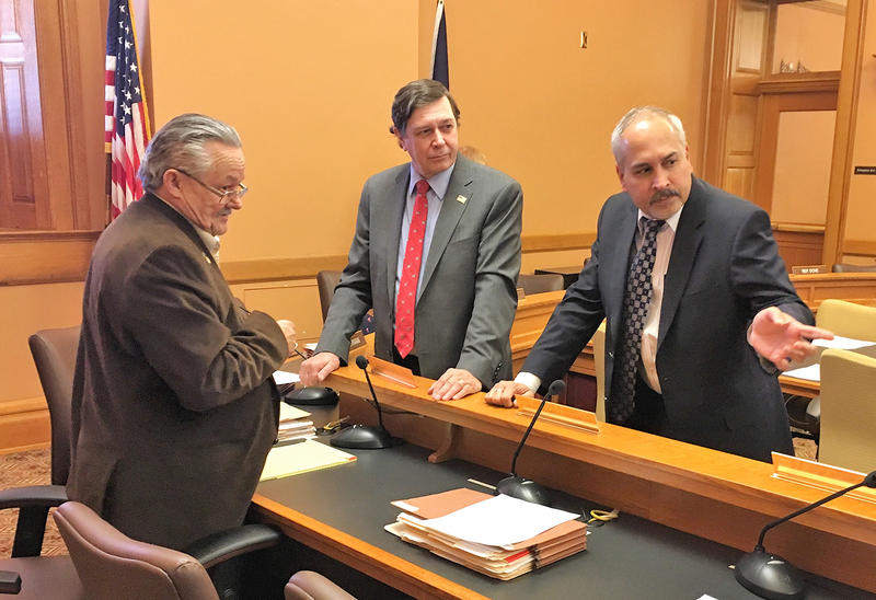 Buddhadeb Dawn, right, executive director of the Midwest Stem Cell Therapy Center, talks with Rep. Les Osterman, far left, and David Prentice, center, of Charlotte Lozier Institute. Dawn provided an update on the center's research Tuesday in Topeka.