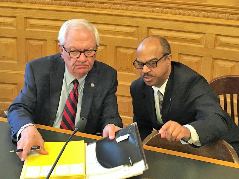 Sen. Rick Wilborn, left, and Sen. David Haley confer at a hearing of the Kansas Senate Judiciary Committee. On Wednesday the committee heard testimony on a bill that would increase the penalty for hate crimes.