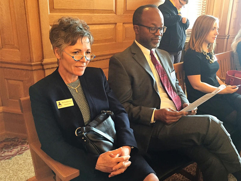 Cynthia Lane, left, superintendent of the Kansas City Kansas School District, and David Smith, the district's chief of staff, listen Tuesday to the outline of a new school funding formula.