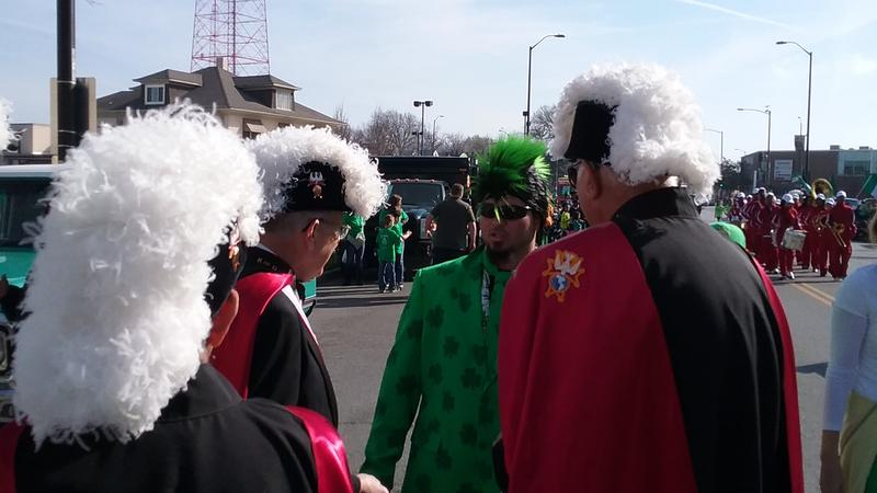 A feathered crest showdown at Kansas City's St. Patrick Day Parade.