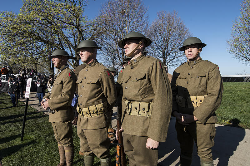 "A group of American soldiers in period ""doughboy"" uniform await orders before the start of the commemoration at the the National WWI Museum and Memorial April 6, 2017, in Kansas City, Missouri."
