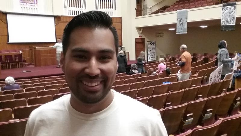 Manny Abarca, IV, who founded the University of Central Missouri's Office of Sustainability and now works for Rep. Emanuel Cleaver, emceed at the rally.