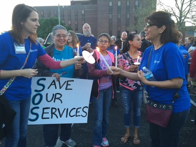 Hundreds of people attended a vigil Monday evening outside St. Francis Health in Topeka, a financially struggling hospital that is at the center of the Medicaid expansion debate in Kansas.