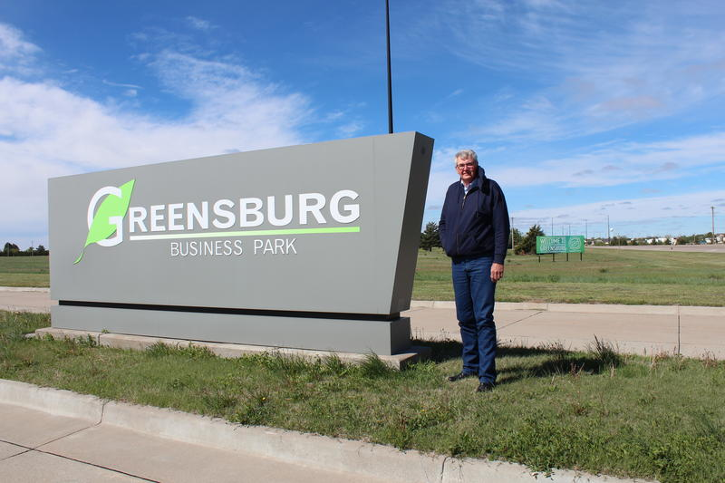 Greensburg, Kansas, Mayor Bob Dixson stands at the entrance to the town's empty business park.