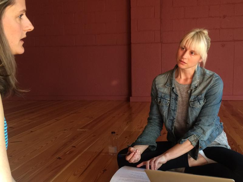 Ayurvedic medicine practitioner Sarah Kucera (right) takes notes during a patient consultation.