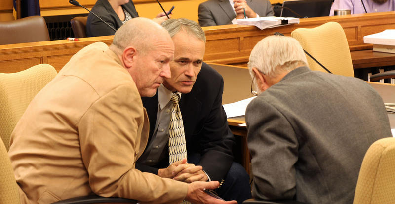 Reps. Larry Campbell, Ed Trimmer and Clay Aurand huddle during a brief break in Sunday's negotiations on school finance. Members of the House and Senate agreed to tie a tax overhaul into a school finance bill.