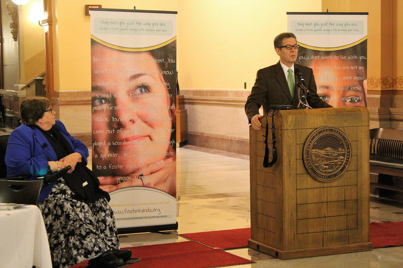 Gov. Sam Brownback on Friday signed a bill creating a task force to examine the Kansas foster care system. He spoke at a May event to recruit foster care parents with Phyllis Gilmore, left, secretary of the Kansas Department for Children and Families.