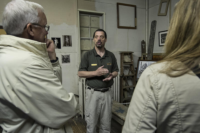 Historic Site Administrator Steve Sitton leads a tour in the modest studio where Thomas Hart Benton painted regionalist scenes of American life.