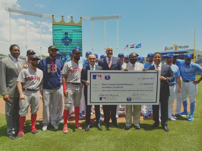 A ceremonial check presentation before Wednesday afternoon's game at Kauffman Stadium.